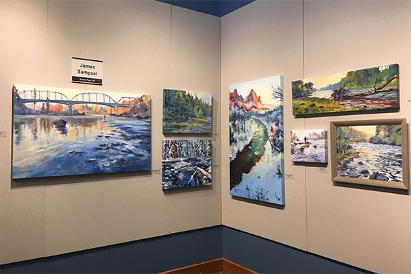 paintings hanging in a gallery