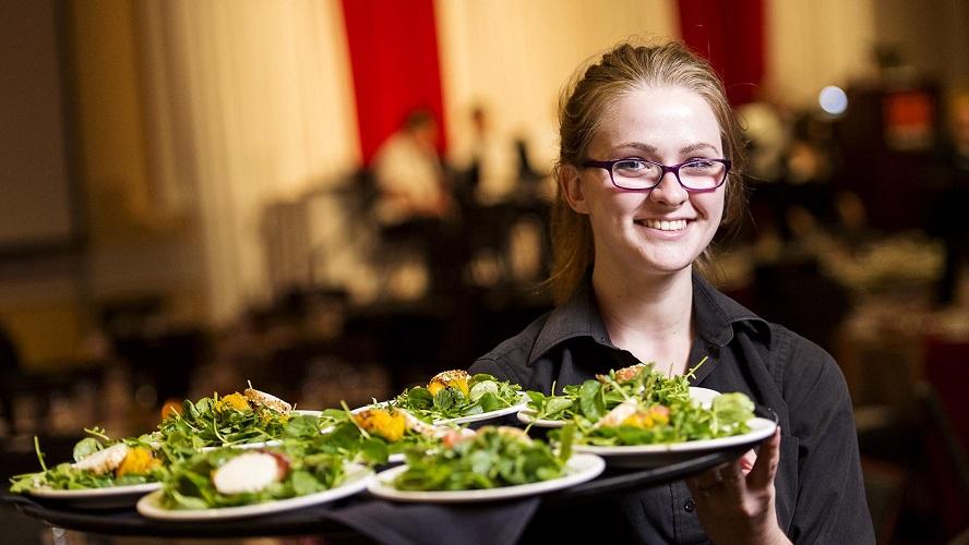 University Catering server holding tray