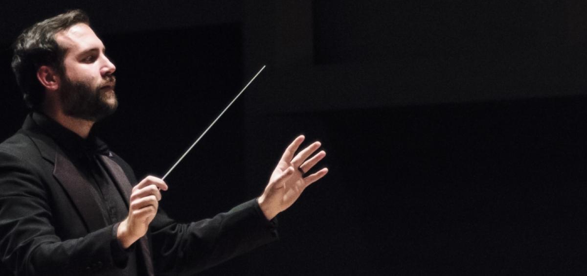 Olin Hannum, conducting.